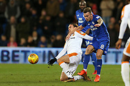 Joe Ralls of Cardiff City ® tackles Jackson Irvine of Hull city. EFL Skybet championship match, Cardiff city v Hull city at the Cardiff city stadium in Cardiff, South Wales on Saturday 16th December 2017.<br /> pic by Andrew Orchard, Andrew Orchard sports photography.