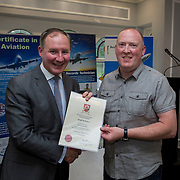 24.05.2018.       <br /> The Limerick Institute of Technology with Atlantic Air Adventures and funding from the Aviation Skillnet presented over forty certificates to Aviation professionals who have completed the Certificate in Aviation, The Aircraft Records Technician Level 7 and Part 21 Design, Level 7.<br /> <br /> Pictured at the event was Jim Gavin, The Irish Aviation Authority and Manager of the Dublin Football Team who presented, Daragh McDermott with their cert.<br /> <br /> LIT in partnership with Atlantic Air Adventures, CAE Parc Aviation, Part 21 Design and industry experts such as Anton Tams, GECAS, Don Salmon, CAE Parc Aviation and Mick Malone, Part 21 Design have developed and deliver these key training programmes with funding for aviation companies provided by The Aviation Skillnet.<br /> <br /> . Picture: Alan Place