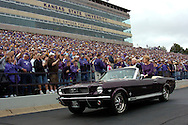 Former Kansas State head coach Bill Snyder and his wife Sharon drive around the newly named Bill Snyder Family Stadium, before the Wildcats 24-23 win over Illinois State in Manhattan, Kansas, September 2, 2006.