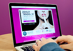 PICTURE POSED BY MODEL A man wearing a wedding ring looks at the Ashley Madison website, as a second wave of personal data alleged to have come from the adultery site has been published online by the site's hackers.