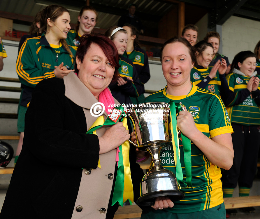 30-04-16. Meath v Galway - Irish Daily Star National Camogie League Division 2 Final at St. Brendan's Park, Birr.<br /> Cait Ni Naraigh, President, National Camogie Association presenting the National Camogie League Division 2 Cup to Meath Captain Aoife Maguire.<br /> Photo: John Quirke / www.quirke.ie<br /> ©John Quirke Photography, Unit 17, Blackcastle Shopping Cte. Navan. Co. Meath. 046-9079044 / 087-2579454.
