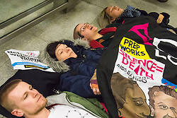 "St Pancras, London, January 16th 2016. Dozens of protesters hold an ""emergency demonstration and die-in"" as France prepares to bulldoze the Jungle Camp at Calais. PICTURED: Protesters lie on the ground as part of their die-in at the entrance to the Eurostar terminal from the London Underground. ///FOR LICENCING CONTACT: paul@pauldaveycreative.co.uk TEL:+44 (0) 7966 016 296 or +44 (0) 20 8969 6875. ©2016 Paul R Davey. All rights reserved."