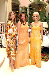 Left to right, LAURE DE CLERMONT-TONNERRE, SASKIA BOXFORD and CAROLINE HABIB at a fashion show of Sybil Stanislaus Summer 2005 collection with jewellery by Philippa Holland held at The Lanesborough Hotel, Hyde Park Corner, London on 13th April 2005.<br /><br />NON EXCLUSIVE - WORLD RIGHTS