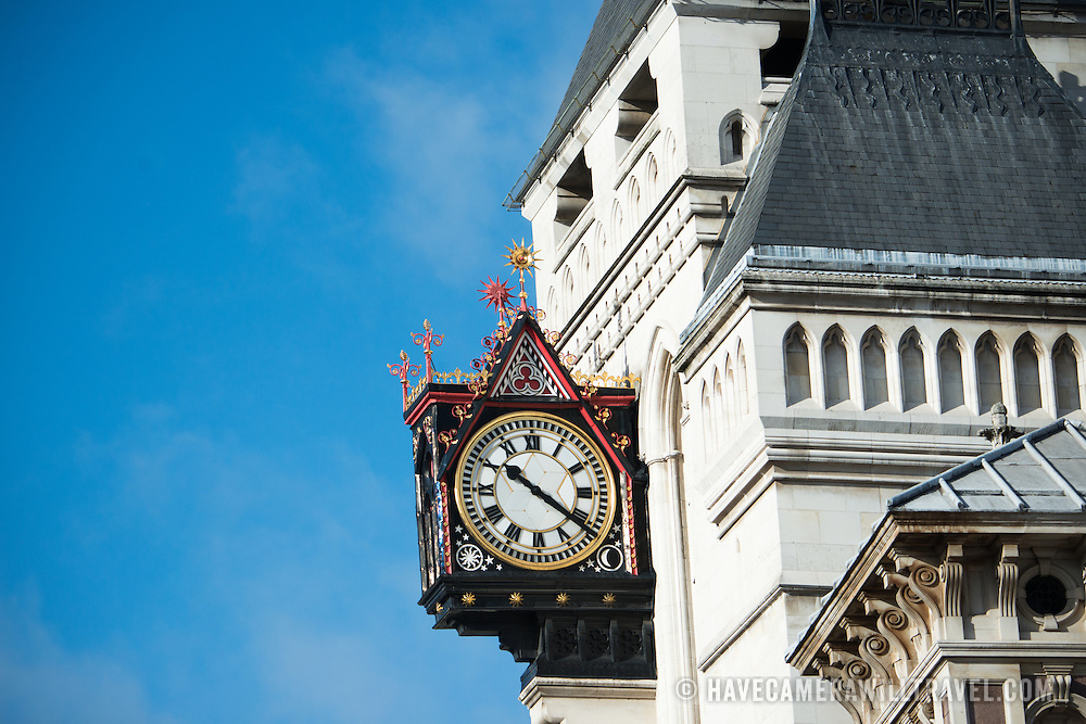 An ornate clock on the outside of a building on Fleet Street in central London.