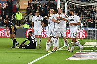 Football - 2018 / 2019 Sky Bet EFL Championship - Swansea City vs. Derby County<br /> <br /> Wayne Routledge Swansea City celebrates the equalise at 1-1, Derby look dejected , at The Liberty Stadium.<br /> <br /> COLORSPORT/WINSTON BYNORTH