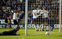 Photograph: Scott Heavey.<br />Leicester City v Tottenham Hotspur. 19/10/2003. FA Barclaycard Premiership.<br />Ex Spurs keeper Ian Walker can do nothing while the Tottenham team celebrate Freddie Kanoute's winner