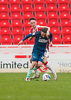 Derby County's Patrick Roberts shields the ball from Stoke City's Jordan Thompson<br /> <br /> Photographer Lee Parker/CameraSport<br /> <br /> The EFL Sky Bet Championship - Stoke City v Derby County - Saturday 20th March 2021 - bet365 Stadium - Stoke-on-Trent<br /> <br /> World Copyright © 2021 CameraSport. All rights reserved. 43 Linden Ave. Countesthorpe. Leicester. England. LE8 5PG - Tel: +44 (0) 116 277 4147 - admin@camerasport.com - www.camerasport.com