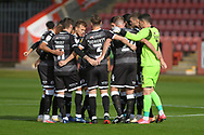 The Crawley team in the pre-match huddle during the EFL Sky Bet League 2 match between Cheltenham Town and Crawley Town at Jonny Rocks Stadium, Cheltenham, England on 10 October 2020.