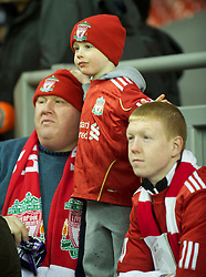 LIVERPOOL, ENGLAND - Wednesday, December 15, 2010: A father takes his two sons to watch Liverpool take on FC Utrecht during the UEFA Europa League Group K match at Anfield. The club offered adult fans four free tickets for children. (Photo by: David Rawcliffe/Propaganda)