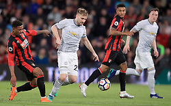 Manchester United's Luke Shaw and AFC Bournemouth's Jordon Ibe (left) battle for the ball during the Premier League match at the Vitality Stadium, Bournemouth.