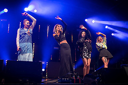 """© Licensed to London News Pictures . 22/08/2014 .  Manchester , UK . NEON JUNGLE perform on the stage in the car park . Manchester Pride """" Big Weekend """" in Manchester's """" Gay Village """" today ( 22nd August 2014 ) . Photo credit : Joel Goodman/LNP"""