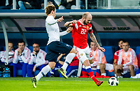 SAINT PETERSBURG, RUSSIA - MARCH 27: RUSSIA-FRANCE. International friendly football match at Saint Petersburg Stadium on March 27, 2018 in Saint-Petersburg, Russia. French's Antoine Griezmann (L) and Russian's Konstantin Raush (R). (Photo by MB Media/Getty Images)