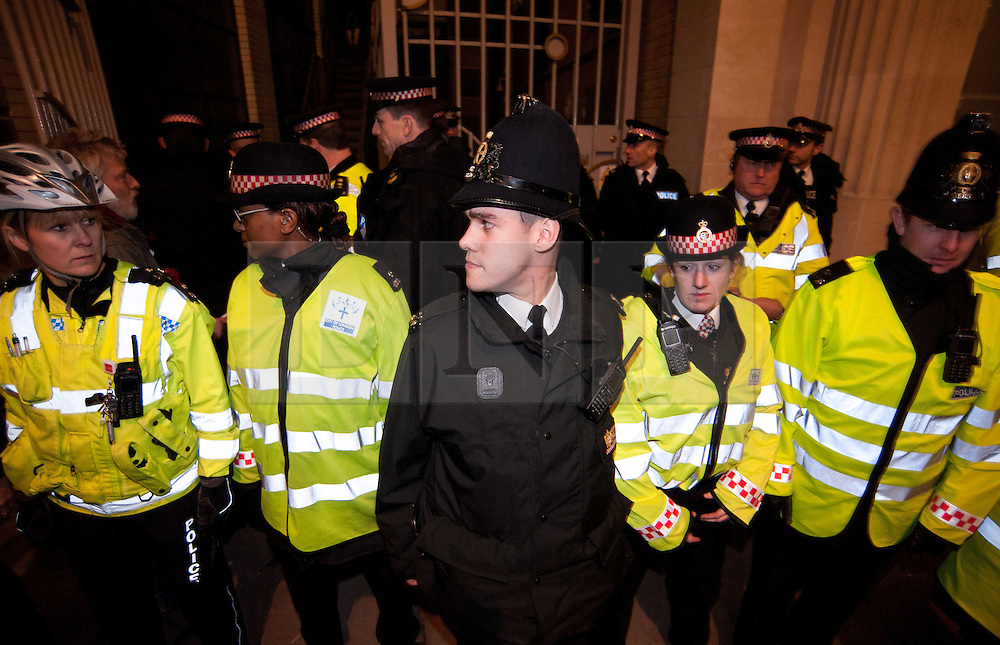 © licensed to London News Pictures. London, UK. 27/01/12. Protestors cleared from new site in the City of London. The 'Bank of Ideas' group, who had occupied the disused Bank of Iraq building at 7-10 Leadenhall, are cleared after it emerged the building is a diplomatic premises under Section 9 of the 1977 Criminal Law Act. Fire services cleared the street after finding a strong smell of Diesel upon entry to the premises and cleared. Photo credit: Jules Mattsson/LNP