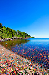 Sugarloaf Cove Minnesota - Founded in 1993 to protect and restore beautiful Sugarloaf Cove, Sugarloaf: The North Shore Stewardship Association promotes the restoration and preservation of the entire North Shore.<br /> <br /> Sugarloaf Cove is a beautiful rocky cove on the shore of Lake Superior in northern Minnesota. Located approximately 73 miles northeast of Duluth and 6 miles south of Schroeder, ownership of the 35-acre site is shared by the Minnesota Department of Natural Resources (DNR) and the Sugarloaf Interpretive Center Association (SICA). Approximately 7.5 acres of the site are dedicated as a Minnesota State Scientific And Natural Area (SNA).
