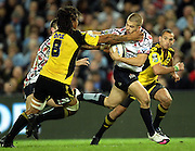 Drew Mitchell tackled by Rodney So'oialo<br />Super 14 rugby union match, Waratahs vs Hurricanes, Sydney, Australia. <br />Saturday 14 May 2010. Photo: Paul Seiser/PHOTOSPORT
