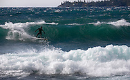 Rory Koff drops into an overhead wave in Incline Village. Waves like this one are a rare treat for surfer's on Lake Tahoe.