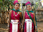 Portrait of two Kayah Red Karen ethnic minority women on 18th January 2016 in Kayah State, Myanmar. Myanmar is one of the most ethnically diverse countries in Southeast Asia with 135 different indigenous ethnic groups with over a dozen ethnic Karenni subgroups in the Kayah region. Kayah women wear a simple red tunic worn with a broad white sash decorated with coloured tassles and a striped hand-woven head-cloth
