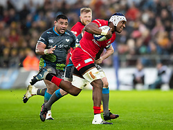 Joel Kpoku of Saracens under pressure from Luke Price of Ospreys<br /> <br /> Photographer Simon King/Replay Images<br /> <br /> European Rugby Champions Cup Round 5 - Ospreys v Saracens - Saturday 11th January 2020 - Liberty Stadium - Swansea<br /> <br /> World Copyright © Replay Images . All rights reserved. info@replayimages.co.uk - http://replayimages.co.uk
