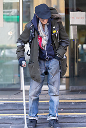 A frail Sean Owen, 56, leaves Highbury Corner Magistrates Court in London where he is facing charges of identity fraud, following previous convictions for the same offence. London, April 17 2019.
