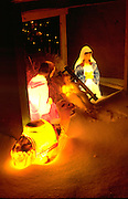 Electric light Nativity scene in front of residential home in snow. St Paul Minnesota USA