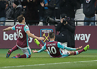 Football - 2016 / 2017 Premier League - West Ham United vs. West Bromwich Albion<br /> <br /> Manuel Lanzini of West Ham poses in front of the West Ham club photographer after giving his side the lead at the London Stadium.<br /> <br /> COLORSPORT/DANIEL BEARHAM