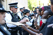 Police argue with hundreds of people have gathered in fron of Downing Street in central London to protest against the killing of an unarmed black man by police in the US. Thousands of protestors marched from Trafalgar Square to the US embassy in South London on Sunday, May 31, 2020. (Photo/ Vudi Xhymshiti)
