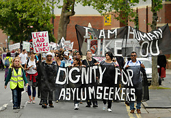 © Licensed to London News Pictures. 30/06/2012. Bristol, UK. Asylum Seekers and supporters march through Bristol, calling for dignity and justice for asylum seekers in the UK.  The English Defence League are due to march in Bristol in 2 weeks time on 14 July.  30 June 2012..Photo credit : Simon Chapman/LNP