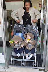 Mother with twins in buggy at launderette. (This photo has extra clearance covering Homelessness, Mental Health Issues, Bullying, Education and Exclusion, as well as the usual clearance for Fostering & Adoption and general Social Services contexts,)