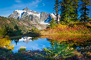 Mount Shuksan in Washington state's North Cascades National Park reflecting in a small tarn