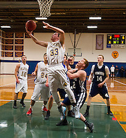 Gilford's Kaleb Orton takes a shot during NHIAA DIvision III Basketball with White Mountain Friday evening.  (Karen Bobotas/for the Laconia Daily Sun)