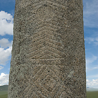 A mysterious 2700+ year-old, bronze age Deer Stone stands on a hillside called Ulaan Tolgoi, near Lake Erkhel & Muren, Mongolia. The patterns probably depict a shamanistic breast plate.