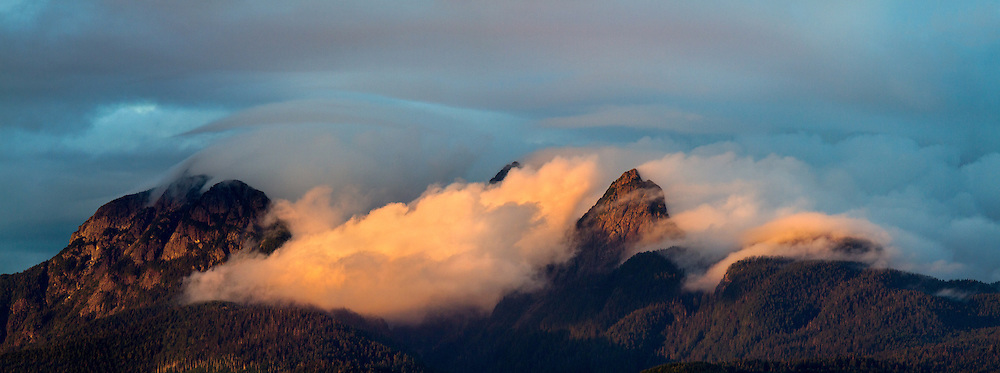 Clouds clearing from Mount Blanshard (The Golden Ears) during sunset - photographed from Tavistock Point at Brae Island Regional Park in Langley, British Columbia, Canada