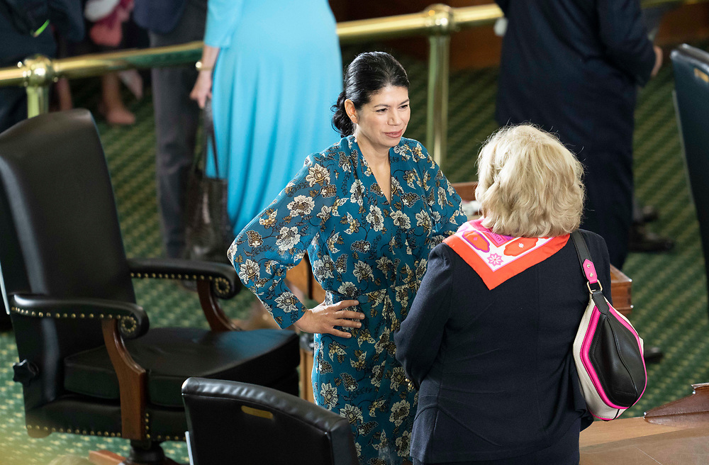 Sen. Carol Alvarado, D-Houston, talks with retiring Sen. Jane Nelson, r, during the opening of the special session on July 8, 2021.
