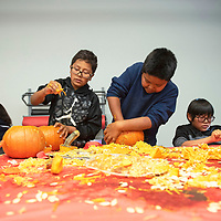Left to right, Ryland, Donnie and Louvelle carve pumpkins Wednesday afternoon at the Office of Diné Youth in Fort Defiance at their pumpkin jamboree, one of their events celebrating Halloween.