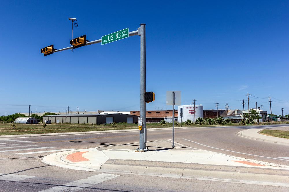 US 83 highway. Empty crossroads with traffic lights, Texas, USA