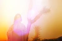 Sunrise meditation and prayer woman