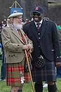 Two men in traditional Scottish kilts laughing before the start of Pipefest Stirling, an event staged at Stirling Castle to coincide with the 700th anniversary of the Battle of Bannockburn. The event was attended by 1600 pipers, Highland dancers and other musicians and formed a procession through the city's streets. The Battle of Bannockburn took place in 1314 and resulted in the defeat of Edward II's English army by the Scots under Bruce.
