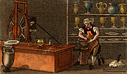 Potter at work at the Wedgwood factory, Etruria, Staffordshire, England.  The potter's throwing wheel is being turned through a belt by the man turning the wheel at the left.   From 'Scenes in England' by the Rev. Isaac Taylor, London, 1822. Hand-coloured engraving.