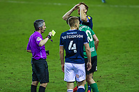 Football - 2020 / 2021 Sky Bet (EFL) Championship - Millwall vs Birmingham City  - The Den<br /> <br /> Referee gives Lukas Jutkiewicz (Birmingham City) a yellow card after a series of bad tackles as Millwall player shows his frustration that it was not a red card<br /> <br /> COLORSPORT/DANIEL BEARHAM