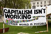 Anti capitalism banner in Parliament Square, London.