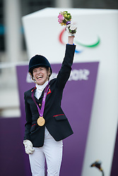 Sophie Christiansen (GBR) celebrates her Gold Medal on the podium<br /> Individual Championship Test - Grade Ia<br /> London 2012 Paralympic Games<br /> © Hippo Foto - Jon Stroud