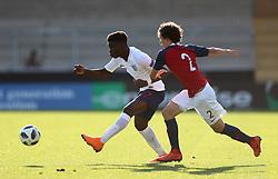 England's Bukayo Saka (left) and Norway's Leo Cornic battle for the ball during the UEFA European U17 Championship quarter final match at the Pirelli Stadium, Burton.