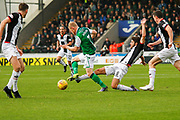 Ryan Flynn of St Mirren goes to ground trying to tackle Daryl Horgan of Hiberninan FC during the Ladbrokes Scottish Premiership match between St Mirren and Hibernian at the Simple Digital Arena, Paisley, Scotland on 29th September 2018.