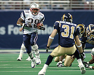 New England Patriots running back Corey Dillon (28) rushes for a Patriots first down as St. Louis Rams safety Adam Archuleta (31) moves in for the tackle, early in the first quarter at the Edward Jones Dome in St. Louis, Missouri.  The Patriots defeated the Rams 40-22, November 7, 2004.
