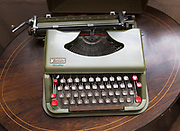 Vintage antares Little Star portable typewriter inside antiques centre, Marlesford Mill, Suffolk, England, UK