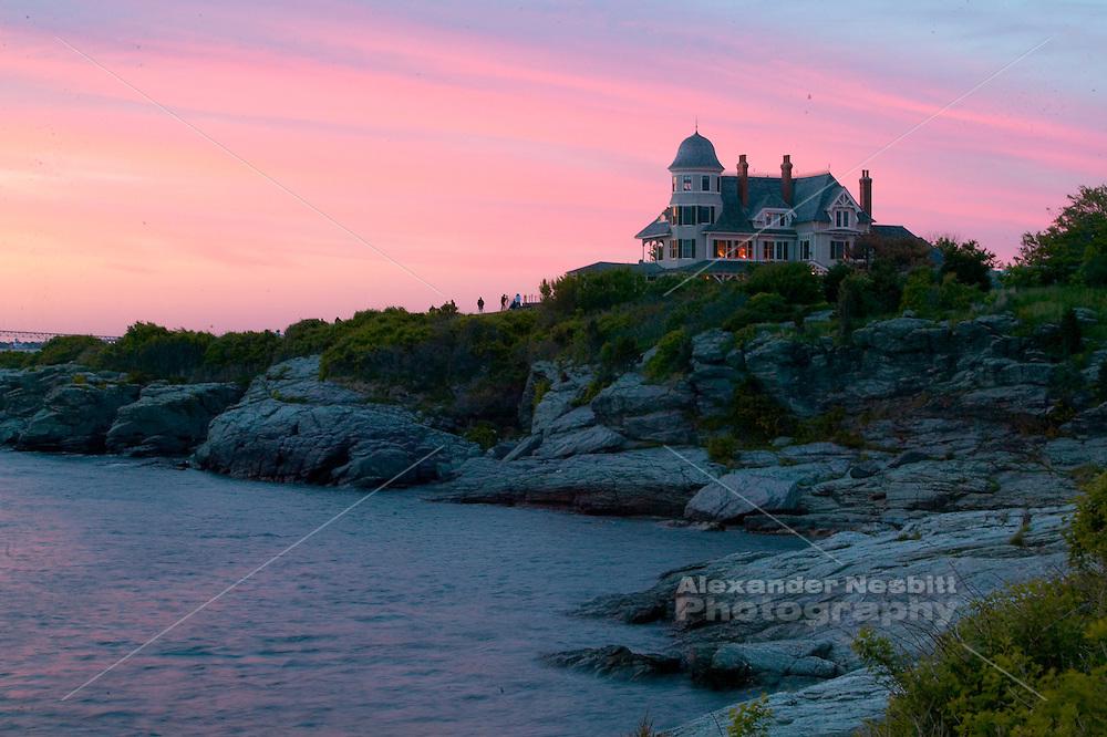 USA, Newport, RI - Castell Hill Inn and Resort overlooks the East passage of Narragansett Bay at sunset with the Newport Bridge beyond.