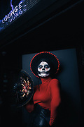 Miguel Robles Tapia, aka Miss Dolce, wears a Dia de los Muertos costume while out in Capitol Hill Saturday night, Oct. 29, 2016. Thousands of Halloween revelers filled the streets and bars in the neighborhood.