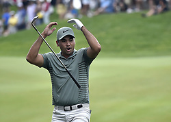 June 24, 2018 - Cromwell, CT, USA - Jason Day reacts to chipping his third shot in for birdie on the 18th hole during the final round of the Travelers Championship at TPC River Highlands in Cromwell, Conn., on Sunday, June 24, 2018. (Credit Image: © Brad Horrigan/TNS via ZUMA Wire)