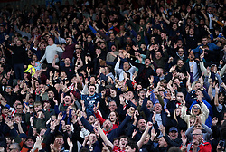 Lincoln City fans celebrate their side's first goal during the Sky Bet League One match at the LNER Stadium, Lincoln. Picture date: Saturday October 16, 2021.