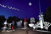 "An ""atomic sculpture"" made from Los Alamos National Laboratory scraps, by Tony Price (1937-2000), of Santa Fe, New Mexico. Tony Price, bought scrap from the nearby Los Alamos National Lab weekly public auctions, and built sculptures which convey anti-nuclear themes and messages. (1988). Seen here ""The Last S.A.L.T. Talks"" sculpture group. (1988)"